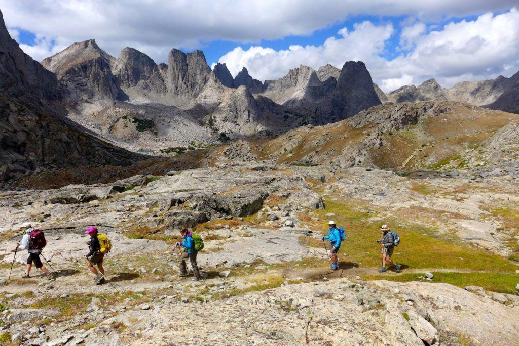 Leading some friends on a training hike over Jackass Pass, with Cirque of the Towers in the background.